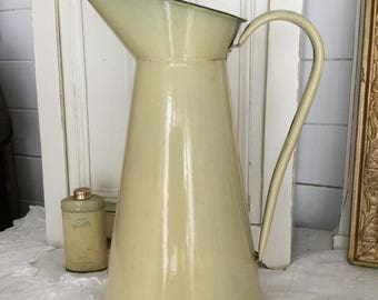 Old water pot, yellow, enamel, shabby