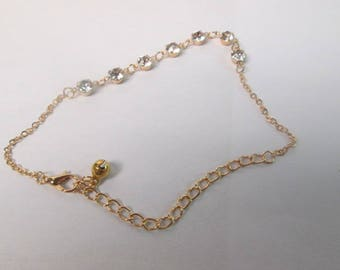 Rose tone 11 '' anklet with 7 round cubic zirconia stones.