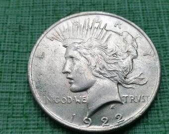 choice au peace silver dollar