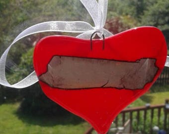 Red glass heart. Red fused glass heart with sterling silver foil feature. Looks lovely in the window or on your wall. Suncatcher.