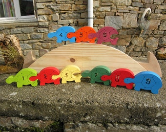 Wooden puzzle of turtles's keuleuleu mulicolors poour learn to count from 1 to 9