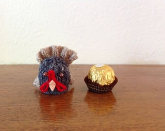 A hand knitted turkey for Thanksgiving or Christmas or any occasion to cover a Ferrero Rocher chocolate or similar.