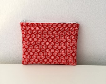 Red fabric flowers white purse