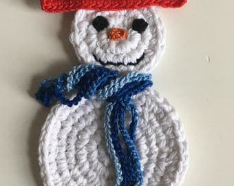 Crochet snowman with red hat and blue scarf magnet