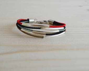 Multistrand silk bracelet with silver plated finishes
