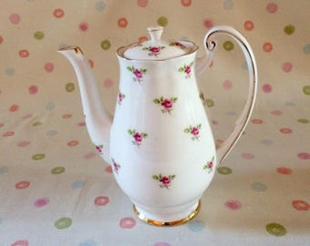 Bone china coffee pot by Royal Standard, pretty rose bud design.
