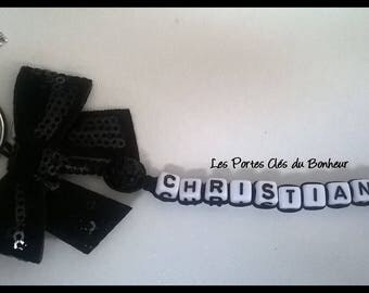 key 1 black name with bow