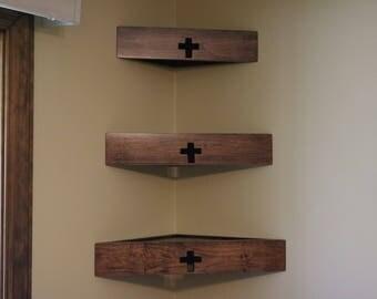 Set of three decorator wood corner wall shelves with cross.