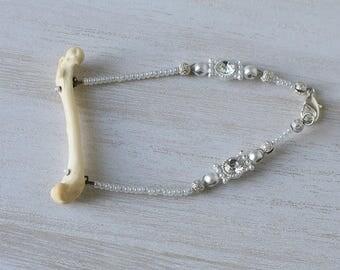 Authentic bone, loose bracelet with white beading and swarovski crystals/rhinestones