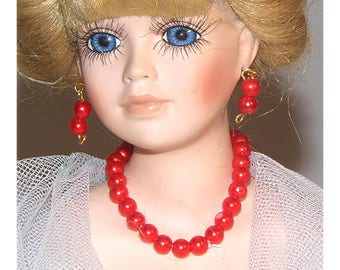"Ritzy and regal is this little red necklace and earring set for 15-18 "" dolls.  Handmade by Nims"