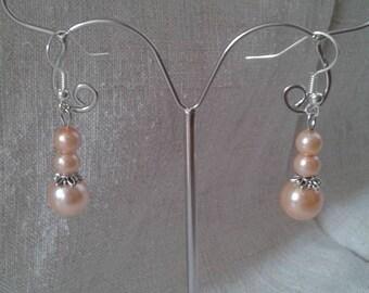 """three salmon Pearl"" earrings"