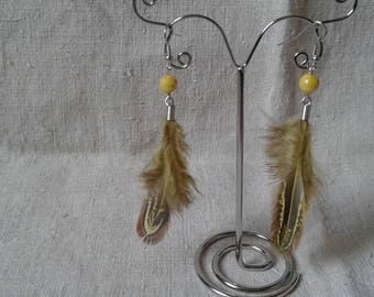 Pearl and yellow feather earrings