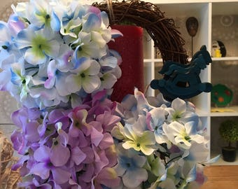Small flower wreath with blue rocking horse's