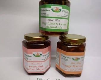 3 x 300g HOME MADE marmalade 3 different flavours - orange/ginger, zingy lime/lemon  and sweet pink grapefruit  FREE postage