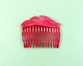 Red comb with soft silicone decoration