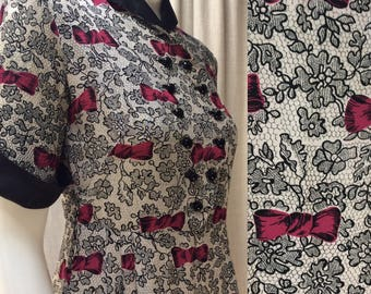 Fabulous Forties crepe dress in a stunning lace and magenta print.