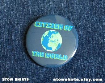 "Citizen of the World 25mm (1""), 38mm (1 1/2"") or 58mm (2 1/4"") pinback button badge or 25mm (1"") fridge magnet."
