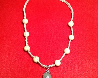 Hemp necklace with wood beads and jade pendant