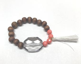 Coral, white, and wood bead bracelet