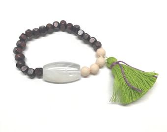 Cream, green, and wood bead bracelet