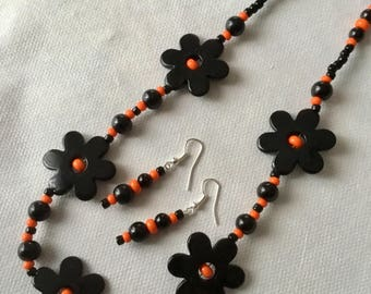 Black and orange flower bead necklace and earring set