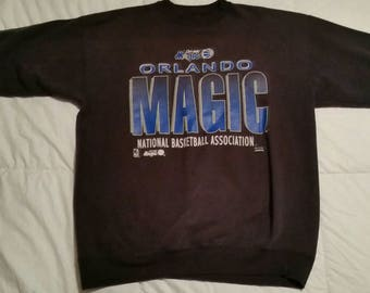 Vintage Orlando Magic faded black sweatshirt. LARGE