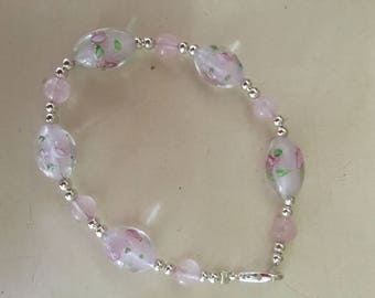 Delicate hand made bracelet using pink lampwork glass and silver beads
