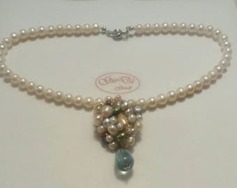 Necklace made entirely of silver handmade, freshwater pearls and fluorite drop