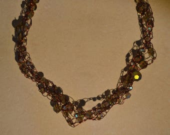 Three strands of glass beads on crocheted copper wire