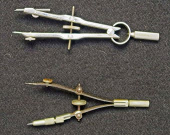 2 Small Compasses, 1 roughly 3 1/2 inches long and the other 4 inches long