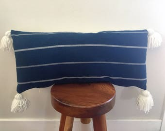 Blue and white striped lumbar pillow cover with tassels