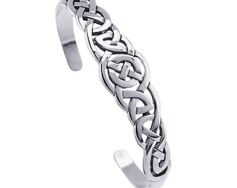 Sterling silver cuff bracelet features an intricate openwork Celtic weave design
