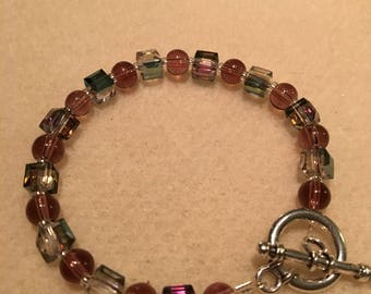 Glass Beaded stretch bracelet with silver-plated toggle clasp, size 7.