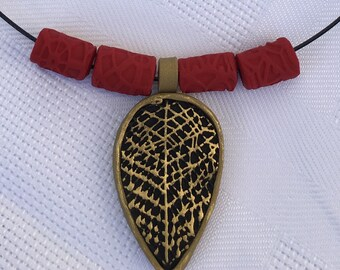 Gold black and red necklace and earrings