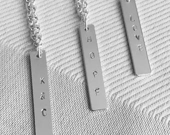 hand stamped metal bar necklace