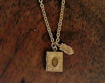 Gold locket with tiny owl charm