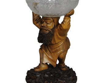 great carving of a dwarf with glass bowl 19th century