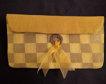 Gold Checkered Clutch with a Flimsy Ribbon Bow