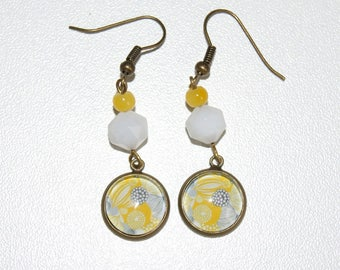 Dangling beads and cabochon earrings