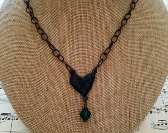 Antiqued heart necklace with dangling vintage glass bead