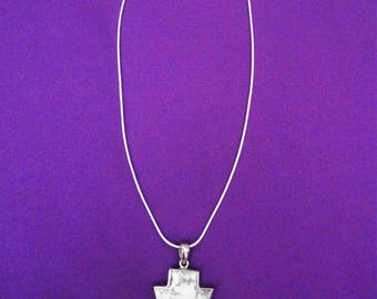 Hand crafted silver charm necklace
