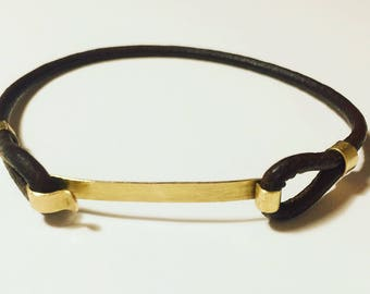 Bracelet, 18 k brushed yellow gold and leather design. Handmade