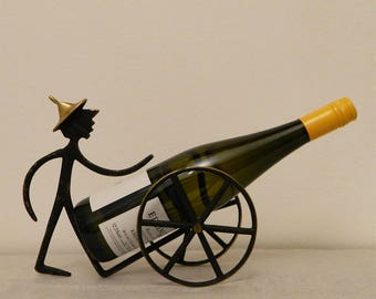 "Walter Bosse bottle holder ""man with carts"""
