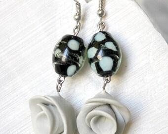 Flower gray green and oval earrings feline pattern.