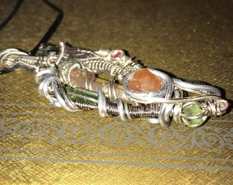 wire wrapped pendant packed with different gemstones