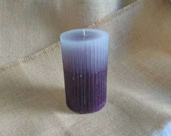 Faded purple round scalloped pillar candle
