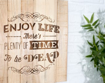 Wooden recycled with phrase recorded - Enjoy Life - sign