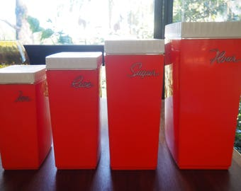 Vintage Capri containers great condition set of 4 script still in tact