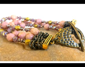 Pink Stone multi-strand beaded bracelet with bronze and brass clasp, Lavender glass bead accents with copper jump rings