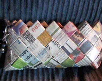 Kitschy wristlet purse made of old newspapers